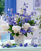 Syringa (lilac), white and Consolida bouquet