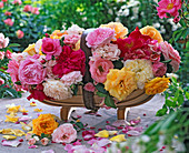 Rose arrangement in English garden basket with bed roses (yellow, pink)