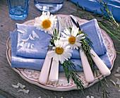 Leucanthemum flowers and grasses on blue cloth napkins