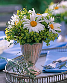 Bouquet of leucanthemum and alchemilla