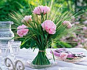 Bunch of stems with barley and peonies