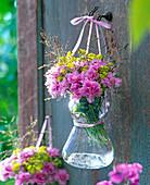 Dianthus (carnation), Alchemilla (lady's mantle), grasses in glass vase