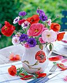 Bouquet from Papaver, Centaurea in milk jug