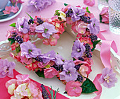 Heart-shaped wreath of delphinium, hydrangea