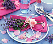 Bouquet of lavandula and rose on pink napkin
