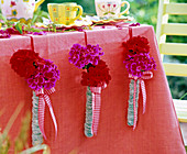 Wrapped glass tubes as vases on the tablecloth