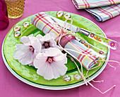 Lavatera (mug mallow, light pink) on a green glass plate