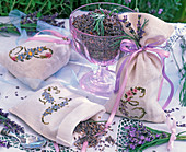 Lavandula dried in glass bowl and embroidered sachets