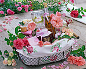 Gift basket with rose flowers, rose jelly, liqueur, and soap