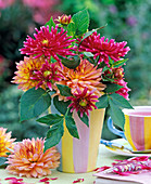 Bouquet made of dahlia in striped vase