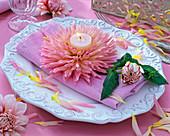 Pink blossom of dahlia (cactus dahlia) with tealight