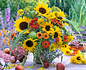 Late summer bouquet with Helianthus (sunflower), Zinnia (Zinnia)