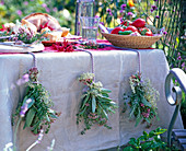 Herbs as table decoration with bouquets of salvia, rosmarinus