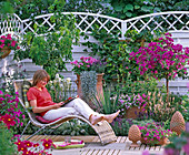 Patio with a Mediterranean ambience, woman on basket lounger