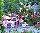 Purple-pink bed in front of blue wickerwork