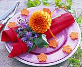Small bouquet of Dahlia and Borago on napkin