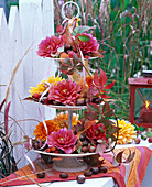 Etagere filled with flowers of Dahlia and Aesculus