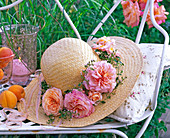 Hat decorated with flowers of pink (rose)