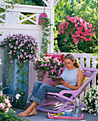 Petunia balcony with pink wooden lounger
