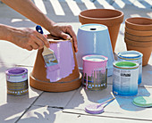Clean and paint clay pots