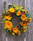 Late summer wreath with marigolds and rowanberries