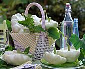 Cucurbita, foliage, fruits in white basket