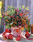 Berries, fruits and autumn leaves bouquet