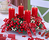 Advent wreath with Abies procera, red candles, red balls