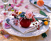 Rose rosehips and malus on white napkin