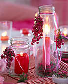 Erica on screw lid jars as lanterns, red and pink candle