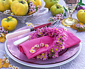Napkin ring made of aster (asters) around pink napkin
