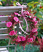 Wreath of Erica and Dianthus on back of wooden chair