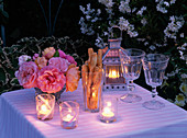 Small bouquet made of pink (rose), lantern, glasses, lanterns