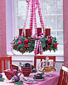 Hanging Advent wreath of Abies procera with red candles