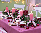 Advent wreath of pink candles in arrangements of Calluna and Cryptomeria