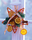 Abies, Citrus, cinnamon sticks on an orange star