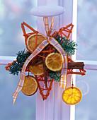 Abies, Citrus, cinnamon sticks on an orange star