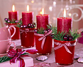 Advent wreath with pinus, red candles, Christmas tree decorations, ribbon