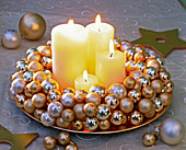 Advent wreath of small golden and silver Christmas tree balls