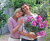 Young couple with Pelargonium grandiflorum