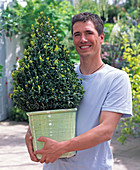 Young man with Buxus (book pyramid)