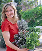 Young woman bought herbs, rosemary, petroselinum