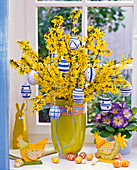 Decorate forsythia bouquet with eggs