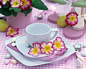 Cup decorated with primula (spring primrose) flowers