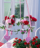 Hanging metal wreath with pink (rose), Hedera (ivy) tendril