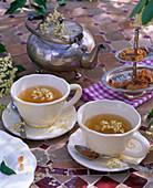 Tea made of flowers of Sambucus nigra in white cups