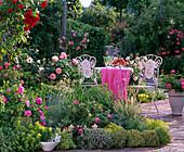Mosaic seating on herbal rose bed