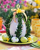 Ceramic egg in a book crown