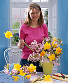 Ornamental cherries and stuck daffodils bouquet