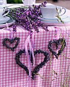 Lavandula hearts sideways at the table, bouquet of lavender